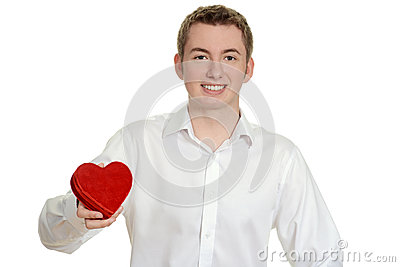 Teen boy holding red heart