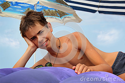 Teen boy on inflatable mattress