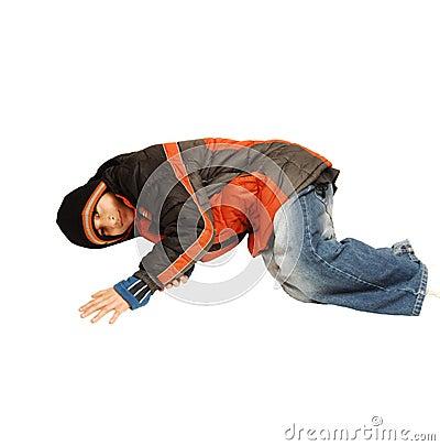 Teen boy lying on the floor.