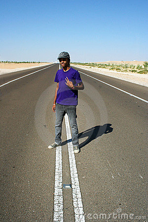 Teen Boy in Middle of Highway