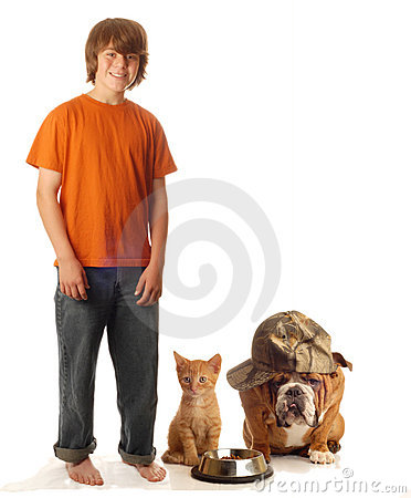 Teen boy with pet dog and cat