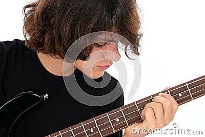 Teen Boy Playing Bass Guitar