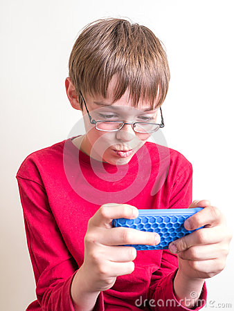 Teen Boy Playing with Cell Phone