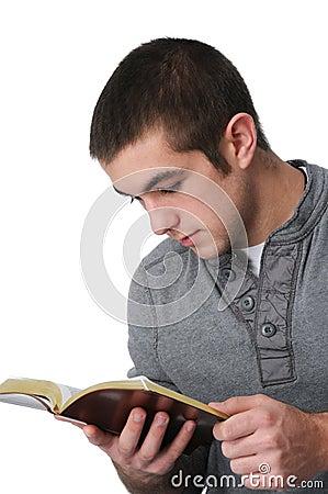 Teen boy reading the bible