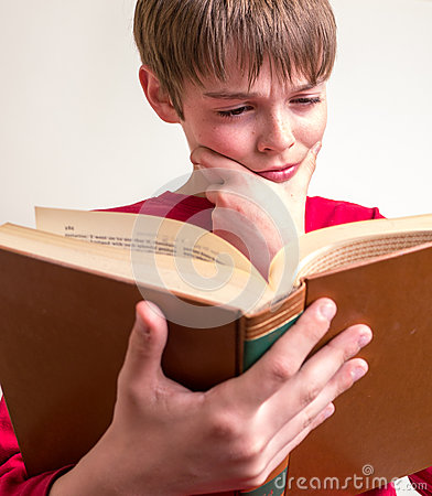 Teen Boy Reading Book
