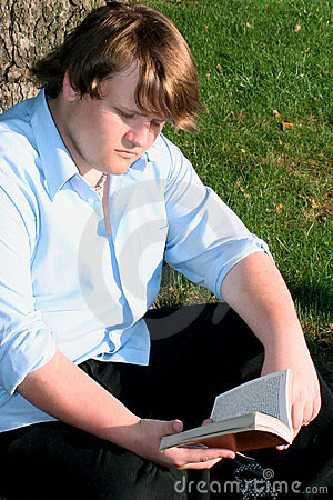 Free Teen Boy Reading Outdoors Royalty Free Stock Photo - 2463315