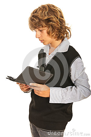 Teen boy reading tablet pc