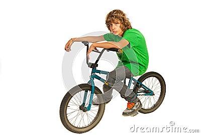 Teen boy resting on bike