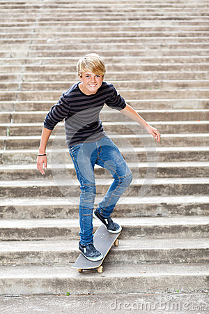 Teen boy skateboarding