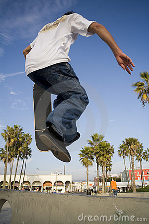 Teen Boy Skateboarding Jumping