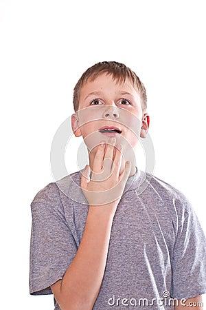 Teen boy surprised