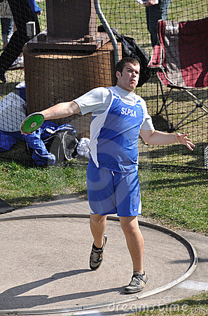 Teen Boy Throwing Discus at High School Track Meet Editorial Photo