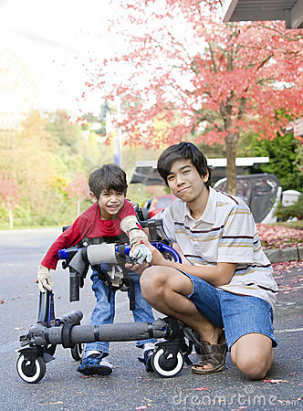 Free Teen Boy With Disabled Little Brother In Walker Royalty Free Stock Photography - 17432567