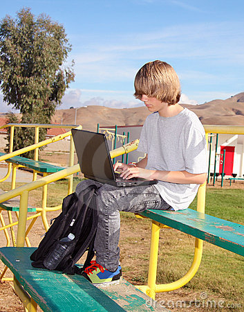 Teen Boy  Working on Laptop