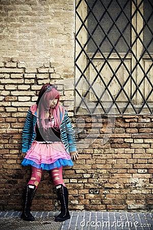 Teen on brickwall