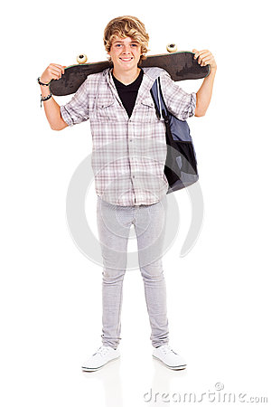 Teen carrying skateboard