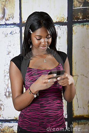 Teen on cellphone texting