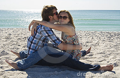 Teen couple on the beach
