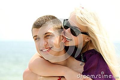 Teen couple embracing