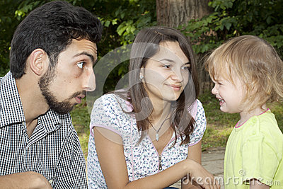 Teen couple with little girl