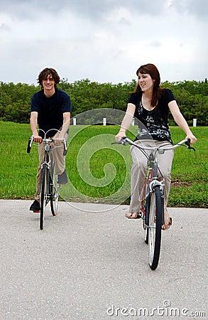 Teen couple riding bikes
