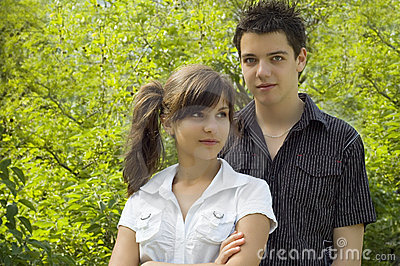 Teen couple smiling