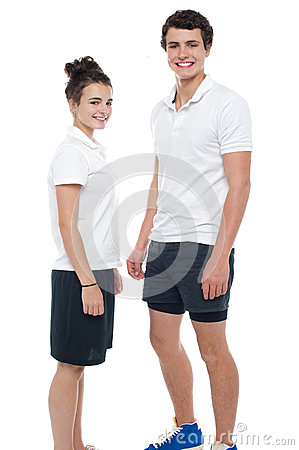 Teen couple in sportswear posing casually
