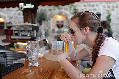 Teen drinking at bar