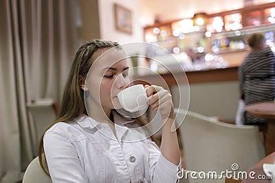 Teen drinking tea