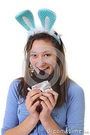 Teen eating chocolate