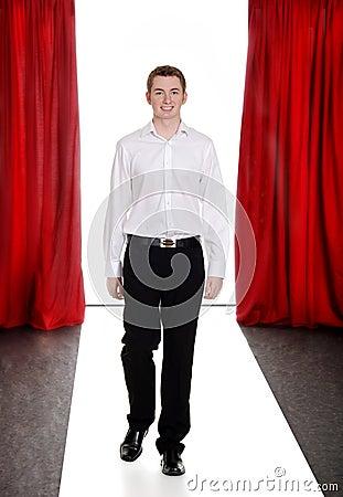 Teen fashion boy on the catwalk