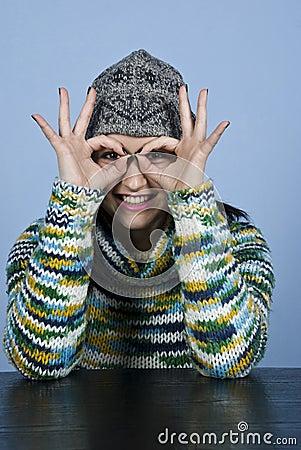 Teen female looking through fingers