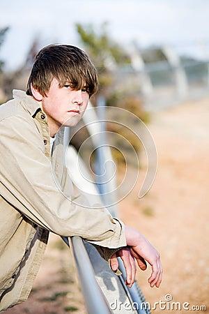 Teen on fence portrait