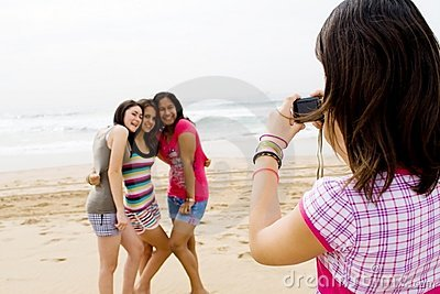 Teen friends taking photos
