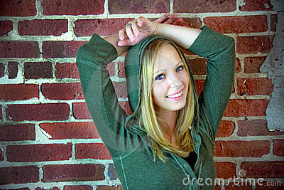 Teen in front of brick wall