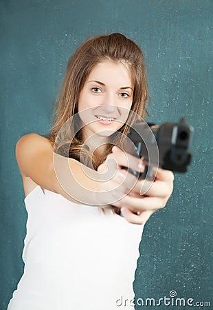 Teen girl aiming a gun