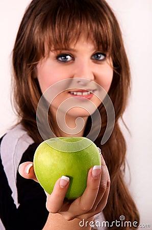 Teen girl and an apple.