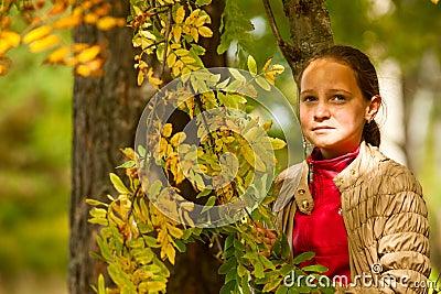 Teen-girl at the autumn park