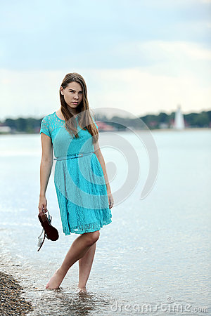 Teen girl at the beach in water