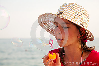 Teen girl blowing bubbles