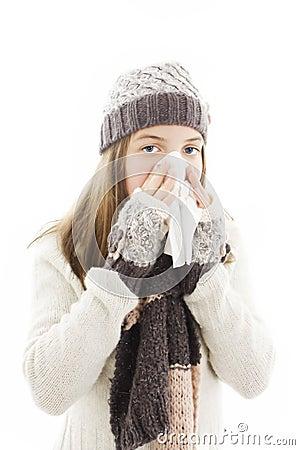 Teen girl blowing her nose.