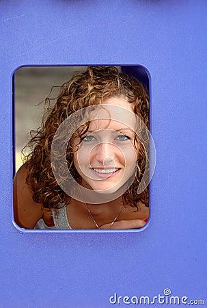 Teen girl in blue window