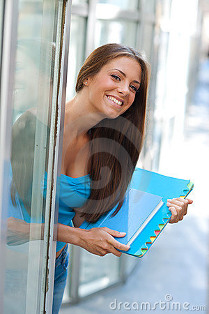 Teen girl with book outside