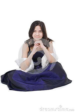 Teen girl in dark blue dress gown