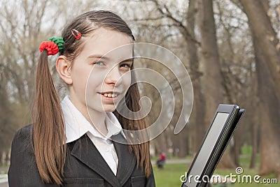 Teen girl with e-book reader