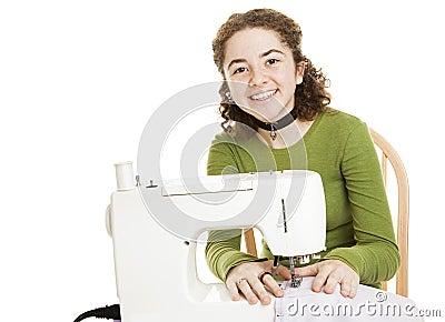 Teen Girl Enjoys Sewing