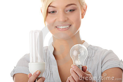 Teen girl environmentalist comparing bulbs