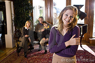 Teen girl with family by piano