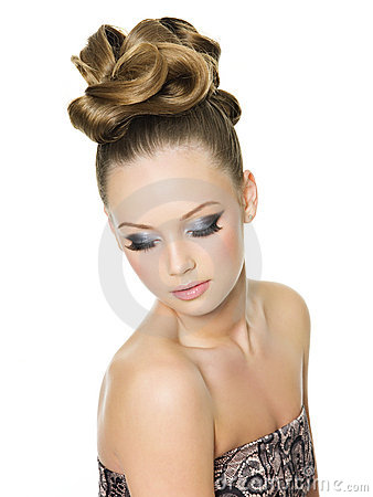 Teen girl with fashion hairstyle and make-up