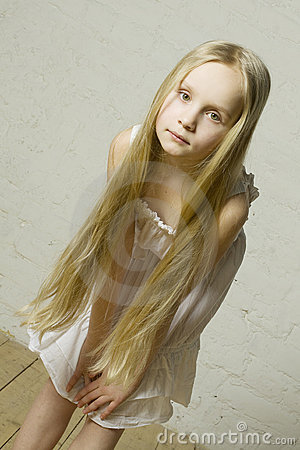Teen girl fashion model with long blond hair